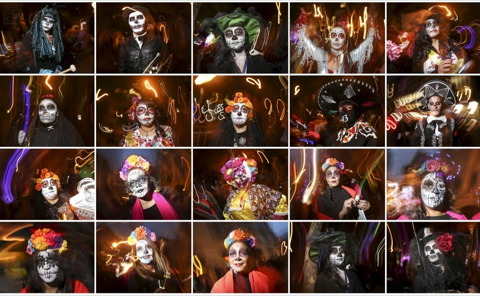 "A combination photograph shows revelers dressed in ""Dia de Muertos"" or ""Day of the Dead"" themes as they pose for photos while taking part in the Greenwich Village Halloween Parade in the Manhattan borough of New York October 31, 2015. REUTERS/Carlo Allegri - RTX1U71D"