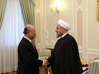 File image of Iranian President Hassan Rouhani (right) and UN atomic agency chief Yukiya Amano. AFP