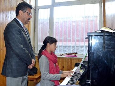 Ahmad Naser Sarmast teaches Tarrannum. DPA