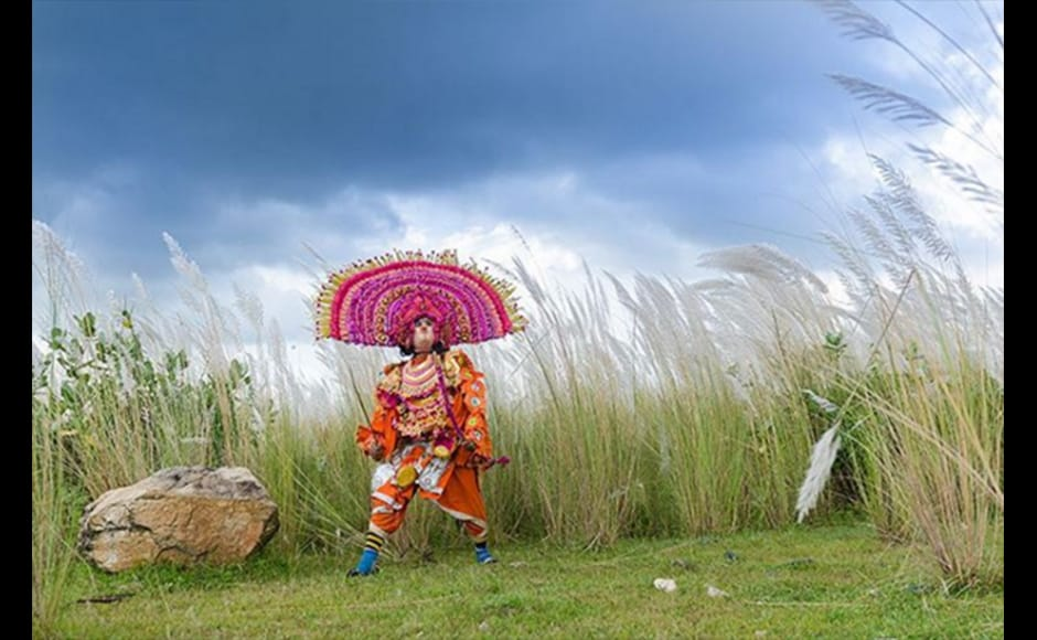 Seasonal flowers named Kash form a beautiful background as a masked Chhau dancer enacts the character of a warrior at Purulia, near Ayodhya Hill in West Bengal in this photograph by 36-year-old Arghya Chatterjee