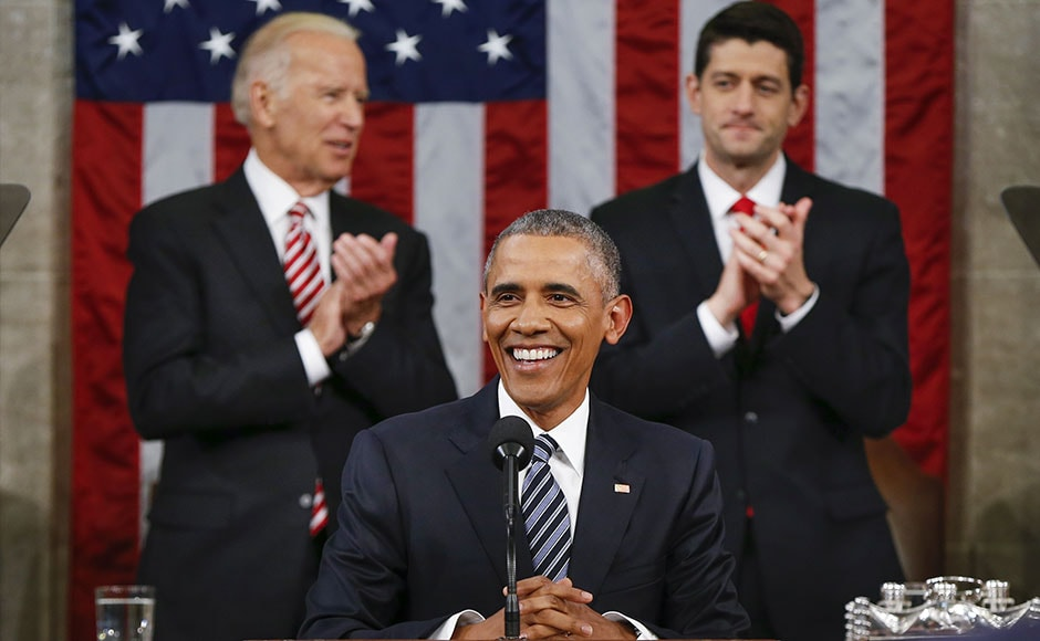 Vice President Joe Biden and Speaker Paul Ryan of Wisconsin applause President Barack Obama during the State of the Union address before a joint session of Congress on Capitol Hill in Washington, Tuesday, Jan. 12, 2016. (AP Photo/Evan Vucci)