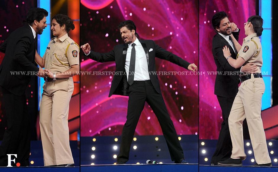 Shah Rukh Khan dances with a female police officer on 'Gerua'. Sachin Gokhale/Firstpost