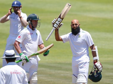 South Africa's Amla celebrates scoring a century with de Villiers during the second cricket test match against England in Cape Town