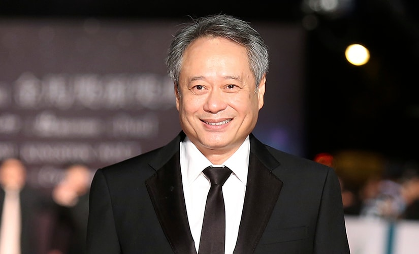 Taiwanese-born director Ang Lee poses for photographers on the red carpet at the 50th Golden Horse Film Awards in Taipei