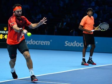 India's Rohan Bopanna (R) and Romania's Florin Mergea return to Netherland's Jean-Julien Rojer and Romania's Horia Tecau in the men's doubles final match. AFP