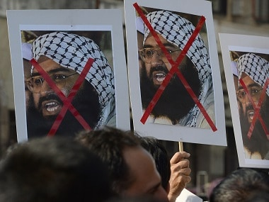 Indian protestors hold up image of JeM chief Maulana Masood Azhar after the Pathankot attack. AFP