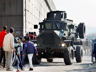 An armored vehicle moves near an Indian Air Force base that was attacked by militants in Pathankot, Punjab on Saturday. PTI