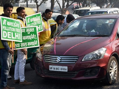 Volunteers with traffic police explaining the rules to an even number car owner near the Nizamuddin Bridge as odd-even scheme restricting movement of private cars, becomes operational in New Delhi on Friday. PTI