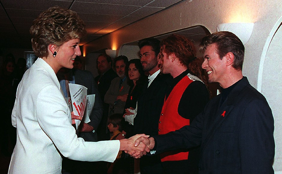 Princes Diana, Patron of the National AIDS Trust, greets singer David Bowie (R) backstage at Wembley Arena in London December 1, before the Concert of Hope to mark World AIDS Day. In the backgroundare singers George Michael and Mick Hucknall of Simply Red. Reuters