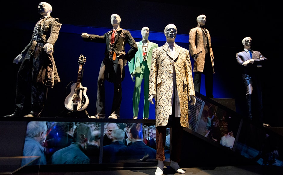 """A variety of stage costumes worn by musician David Bowie are seen at the """"David Bowie is"""" Exhibition at the Victoria and Albert Museum in London March 20, 2013. REUTERS/Neil Hall"""