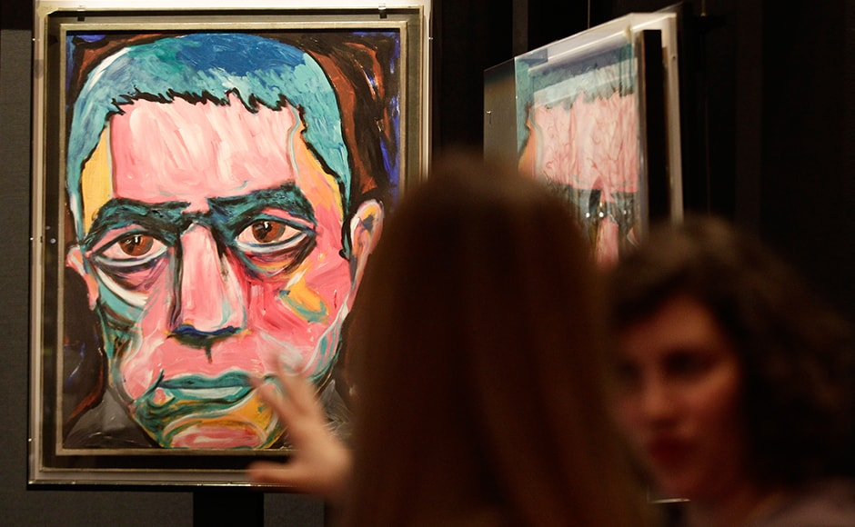 """A painting by David Bowie is set up for the upcoming David Bowie exhibition in Berlin, May 14, 2014. David Bowie's intensely productive Berlin period - when he made the iconic albums """"Heroes"""" and """"Low"""", launched Iggy Pop's solo career and kicked a drug habit - is the theme of a new show adapted from last year's sold-out exhibition in London. The exhibition runs from May 20 till August 10 in the German capital. Reuters"""