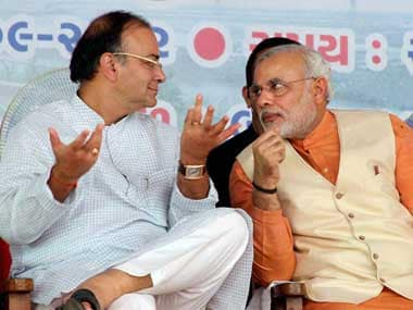 Finance Minister Arun Jaitley (left) with PM Narendra Modi. PTI