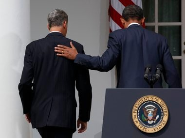 U.S. President Obama and Alan Krueger walk together at the White House in Washington