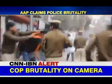 Policemen in Delhi beat up student protesters. Screenshot from IBNLive video.