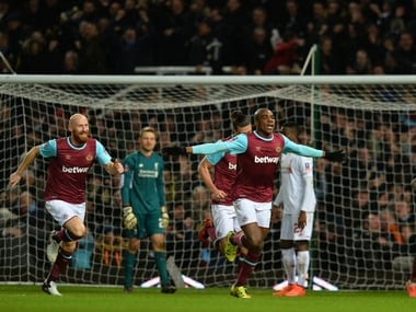 West Ham United's Italian defender Angelo Ogbonna celebrates after scoring the late winning goal in the English FA Cup fourth round replay against Liverpool. AFP