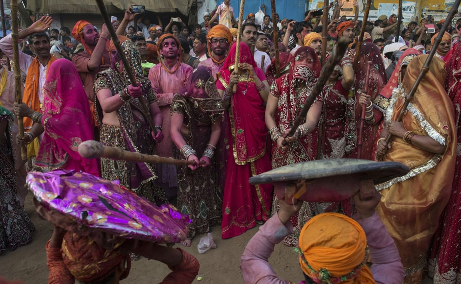 Villagers in Uttar Pradesh's Nandgaon celebrate the Lathmar Holi festival. AFP