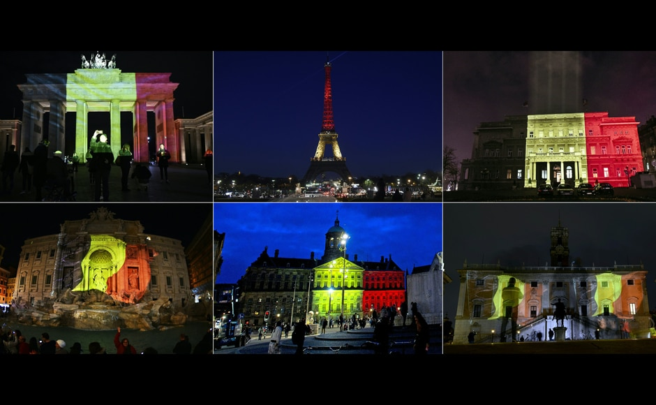The Belgian flag being projected on various landmark monuments (from top L) the Brandenburg Gate in Berlin, the Eiffel Tower in Paris, the town council building in Belgrade, the Trevi Fountain in Rome, the Royal Palace at Dam Square in Amsterdam and Rome's Campidoglio in tribute to the victims of Brussels. AFP
