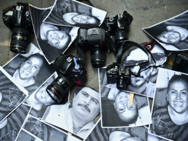 View of photos of killed journalists and cameras outside the Veracruz state representation office during a journalists protest in Mexico City on February 11, 2016. AFP