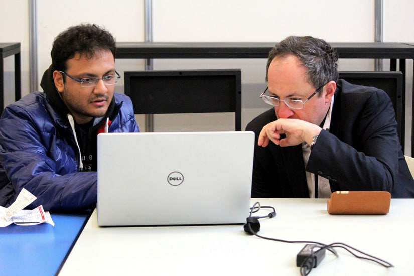 The author discussing Anand's game with Boris Gelfand at the venue in Moscow. Amruta Mokal