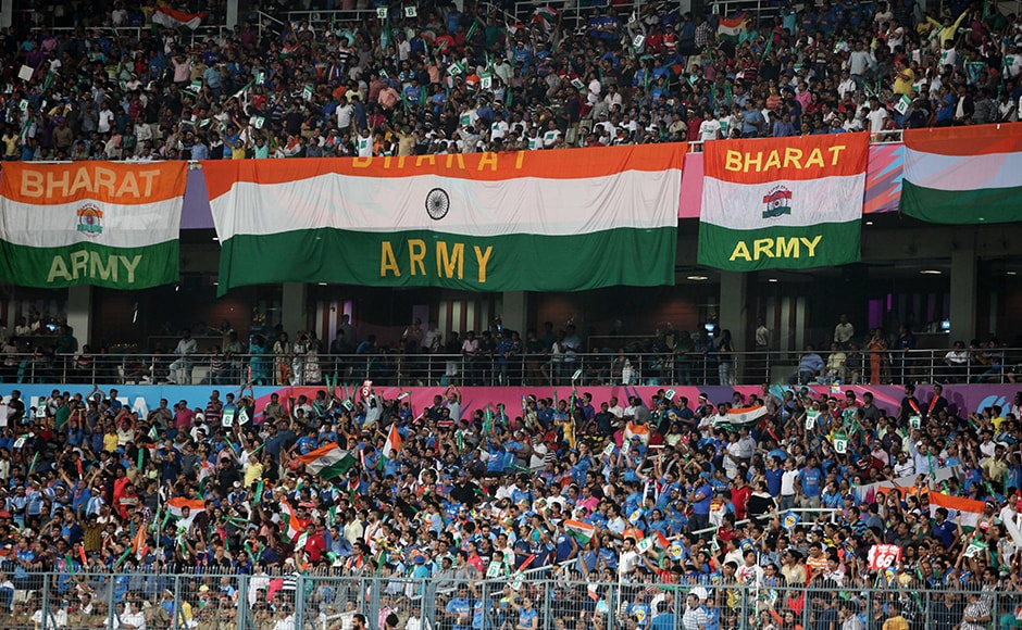 Indian fans cheer during the ICC Twenty20 World Cup match played between Indian and Pakistan at the Eden Garden Stadium in Kolkata, India on March 19, 2016. Getty Images