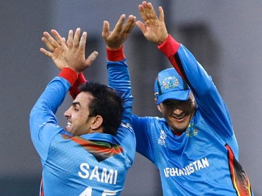 Afghanistan's Samiullah Shenwari (left) and Amir Hamza celebrate their win over West Indies in the World T20 tie in Nagpur on Sunday. AP