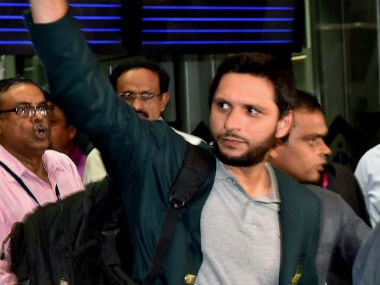 Pakistan captain Shahid Afridi waves to the fans gathered at the Kolkata Airport upon the Pakistan team's arrival for the World T20. PTI