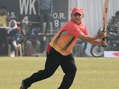 UP CM in action during his match-winning innings against IAS XI. PTI
