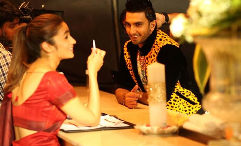 In the second photo, Alia keeps it simple, while Ranveer i the flamboyant one