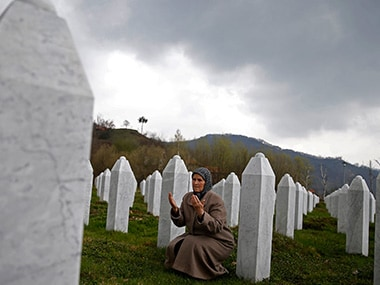 Bida Smajlovic, prays at the Memorial center near the graves of her husband and brother before watching Trial in Hague Tribunal, in Potocari near Srebrenica, Bosnia and Herzegovina. Reuters