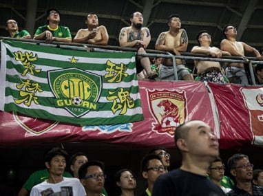 Fans of the Beijing Guoan FC in a match against Chongcing Lifan FC in 2015. Getty Images