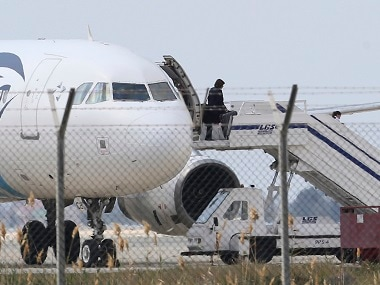 A passenger leaves the hijacked EgyptAir aircraft. AP