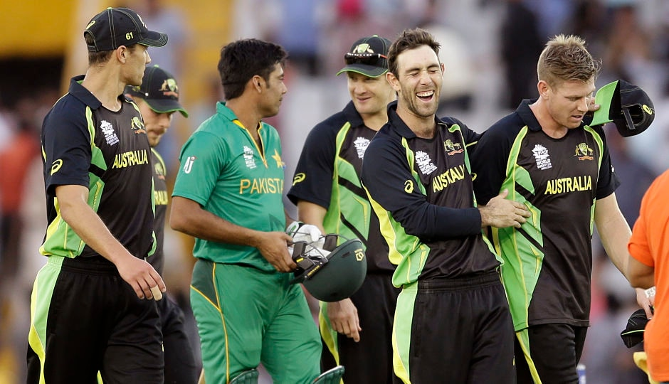 Australia's Glenn Maxwell's shares a joyous moment after win over Pakistan as a disappointed Mohammed Sami looks on. AP