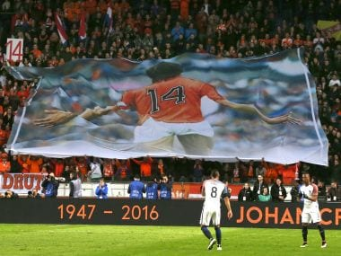 A banner of Johan Cruyff is seen as players observed a minute of silence in the 14th minute during a recent friendly. AP