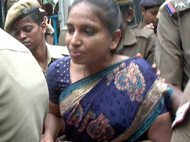 Nalini being escorted by police personnel. File photo. PTI