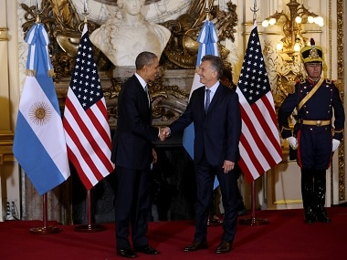 Argentina's President Mauricio Macri, shakes hands with US President Barack Obama, left, at the government house in Buenos Aires. AP