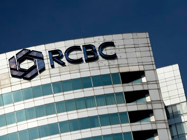 The logo of the RCBC bank is seen at the RCBC building in Manila's financial district. AFP