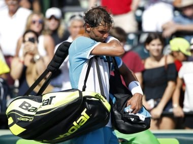 Rafael Nadal leaves the court after retiring from his match. AP