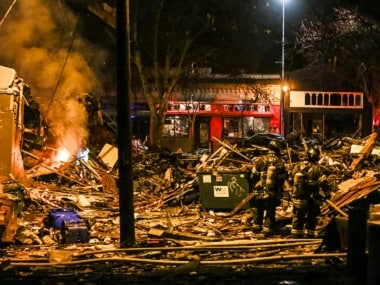 Firefighters work at the scene of a building explosion in Seattle's Greenwood neighborhood early Wednesday. Genna Martin/seattlepi.com via AP