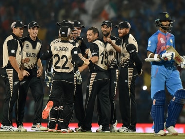New Zealand players celebrate as Shikhar Dhawan returns to the pavilion during the World T20 match in Nagpur on Tuesday. AFP