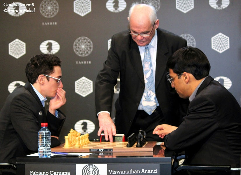 The chief arbiter starts the clock which signals the beginning of the Round 10 game between Viswanathan Anand and Fabioano Caruana at the Central Telegraph Building in Moscow on Wednesday. Amruta Mokal