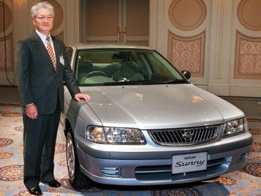 File photo of Yoshikazu Hanawa, President of Nissan Motor Co. Ltd., with a ninth-generation Sunny. AP
