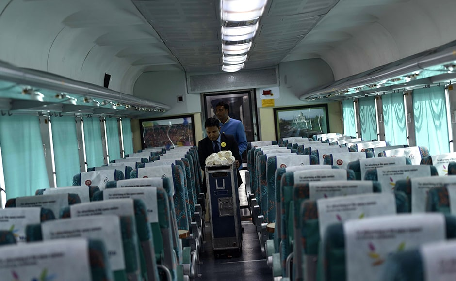 """Indian Railways Staff push a trolley inside a carriage of the 'Gatimaan Express' train in New Delhi on April 5, 2016. India flagged off its fastest-ever train as part of a major modernisation of the crumbling railway system -- but its top speed is only half of those in China and other countries. Railways Minister Suresh Prabhu hailed the Gatimaan Express, running from New Delhi to the Taj Mahal and boasting hostesses and bone china crockery, as """"a new era of high-speed rail travel AFP"""