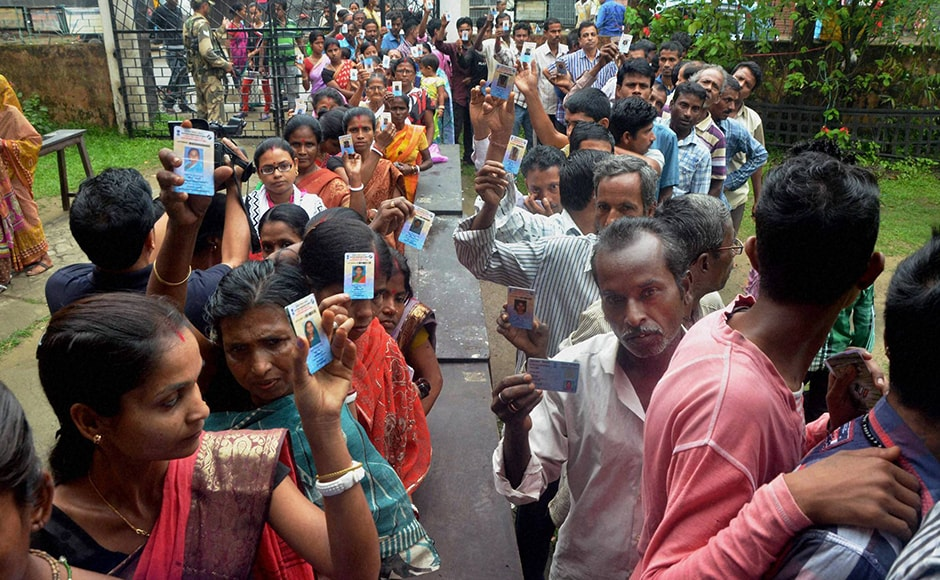 Voters stand in queue at a polling booth in Silchar. Silchar, along with Karimganj North and Karimganj South, has a close political association with the adjoining Left-ruled Tripura. The BJP has renominated for the Silchar constituency sitting legislator Dilip Kumar Paul who bagged the seat in 2014 by elections. PTI