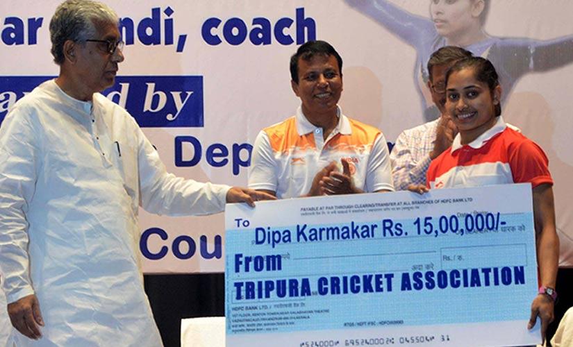 Tripura CM Manik Sarkar felicitating Dipa. Firstpost