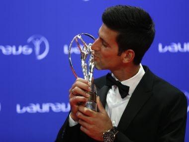 Novak Djokovic with his Laureus World Sportsman of the Year award. Reuters