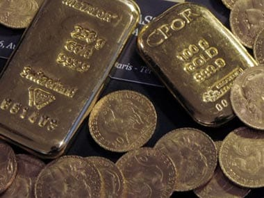 Gold prices ease from 4-week high as dollar, equities strengthen on signs of coronavirus slowdown