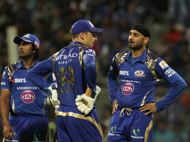 Mumbai Indians player Harbhajan Singh speaks with Jos Buttler during their match against Rising Pune Supergiants. Sportzpics