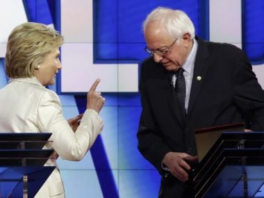 Hillary Clinton and Bernie Sanders. AP