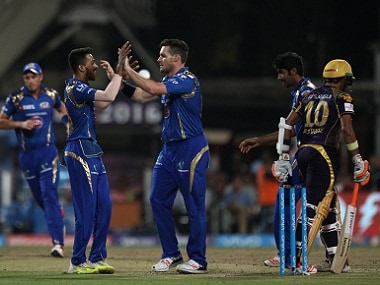 Mumbai Indians players celebrate the wicket of Robin Uthappa of Kolkata Knight Riders. BCCI