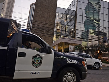 A police car is seen outside the Mossack-Fonseca law firm offices in Panama City during a raid on Tuesday. AFP